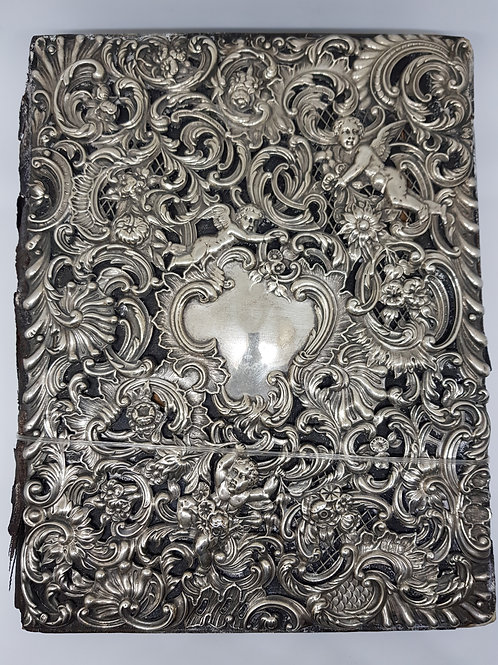 Document holder with sterling silver cover.