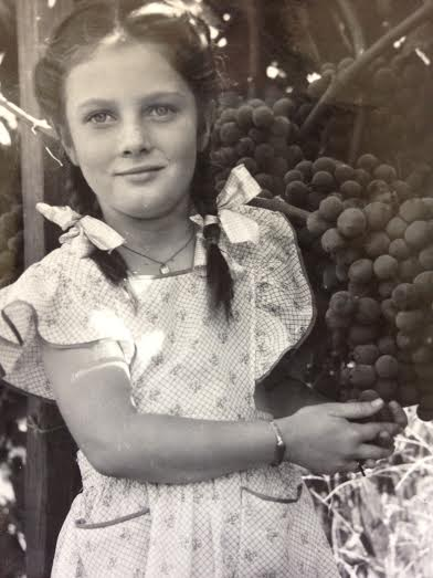 Norene, playing in the vineyard