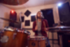 contemporary-bearded-man-playing-drums-C