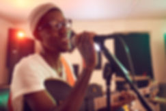 african-young-man-singing-with-band-SHA3