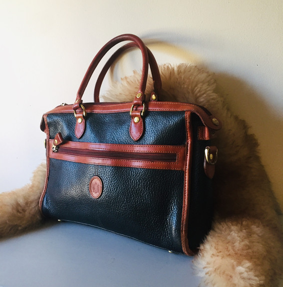 Vintage Black and Tan Leather Handbag with Embossed Logo