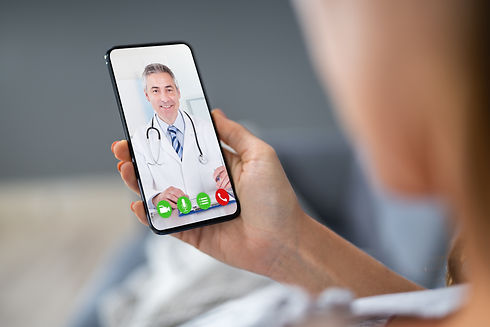 Person Videochatting With Doctor On Mobi