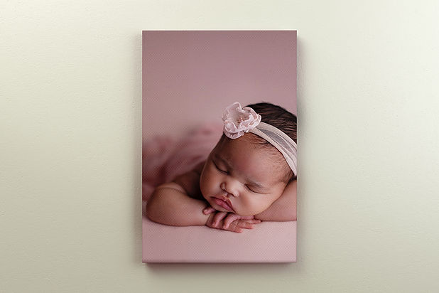 2x3-portrait-canvas-mockup-hanging-on-wa