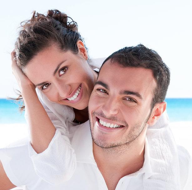 Smiling young couple piggyback at beauti