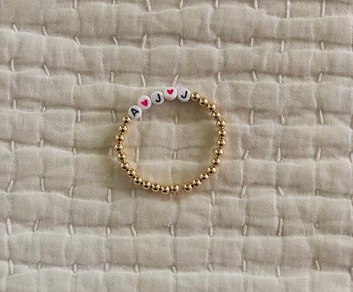 Gold beaded custom bracelet