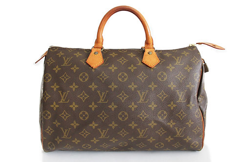 Louis Vuitton Speedy 35 in Monogram Comes with Louis Vuitton dust bag;