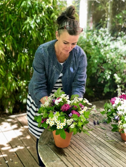 Francesca adds statement flowers to a bouquet
