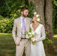 A happy couple with beautiful wedding flowers