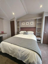 Master En Suite Bedroom with walk in wardrobe and King Sized Bed.