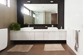 Double Basin Vanity And Mirror In Contemporary New Bathroom.jpg
