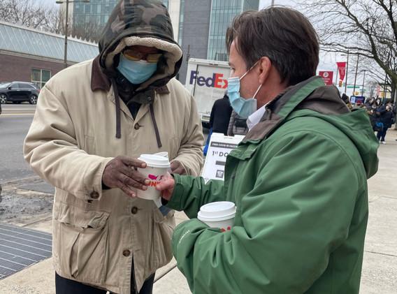 Judge John Padoav serves coffee to resid