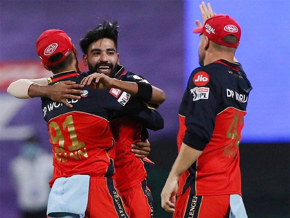 In the 39th match of the Indian Premier League (IPL) 2020, Royal Challengers Bangalore (RCB) beat Kolkata Knight Riders (KKR) by 8 wickets at Sheikh Zayed Stadium in Abu Dhabi. Mohammed Siraj shined for the RCB with him grabbing 3 wickets in his spell of 4 overs, out of which 2 were maiden ones. Kolkata Knight Riders registered their lowest 20-over total in the history of IPL tonight. KKR's batting line-up collapsed before the might of RCB's bowlers as they gave a very low target of 85 runs for the RCB to chase tonight, which they did in the 14th over itself. With their massive win tonight against KKR, Royal Challengers Bangalore now stands at the 2nd position in the points table of the 13th edition of the IPL after dethroning Mumbai Indians (MI) tonight. However, KKR continues to stand at the 4th position in the points table of IPL 2020.