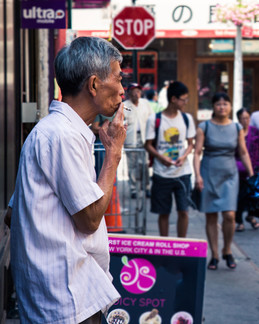 Smoking Man in Chinatown New York by Tom Kai