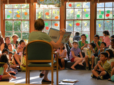 In Virginia this summer, Arlington Public Schools transported students in poor neighborhoods to community libraries for group readings. Studies say children from low-income families may hear roughly 30 million fewer words by age 3 than their more affluent peers. Bill O'Leary/The Washington Post/Getty Images