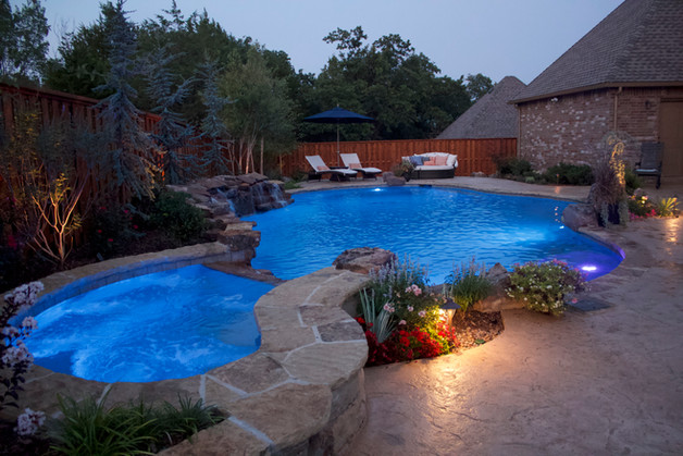 Custom Pools & Spas by Red Valley Landscape & Construction in Lost Creek, Texas