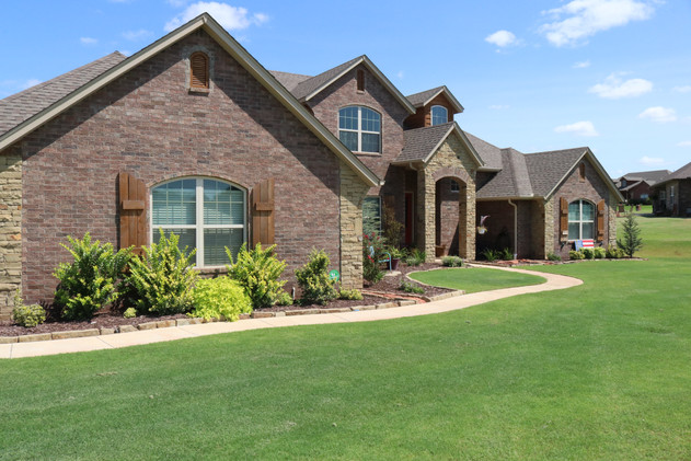 Residential Landscape Maintenance by Red Valley Landscape & Construction in Piedmont, Ok