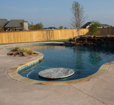 Custom Pools & Spas by Red Valley Landscape & Construction in Briarcliff, Texas
