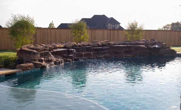 Custom Pools, Spas, and Wate Features by Red Valley Landscape & Construction located in Oklahoma