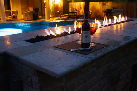 Custom Fire Pits & Fireplaces by Red Valley Landscape & Construction in Okla