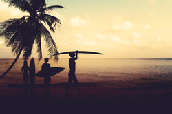 surfers at dusk