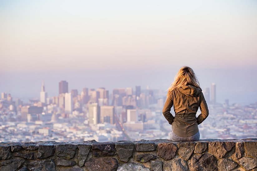 Career coaching for students. Young woman overlooking cityscape.