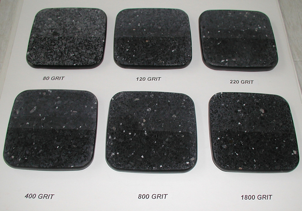 These samples depict black epoxy terrazzo both unsealed and sealed starting at 120 grit to 1800 grit