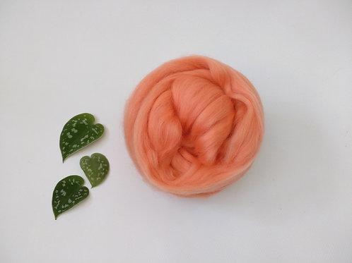 Peach Merino wool roving top