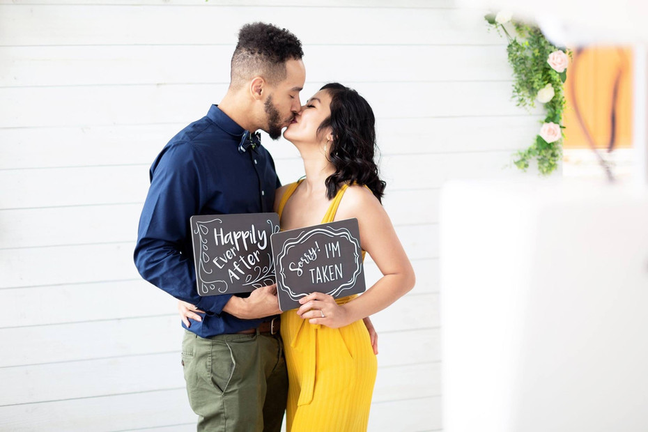 Couple in front of a wedding photo booth