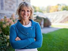 Woman smiling because she seeked individual sex coaching