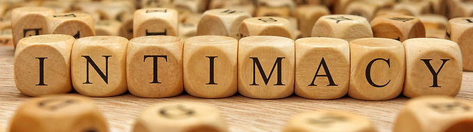 Wood blocks spelling out Intimacy