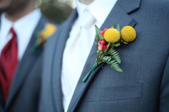 Groom yellow Billy Ball boutonniere
