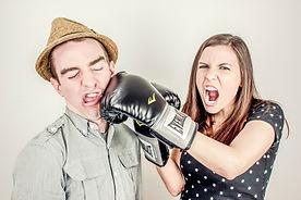 Woman punching man