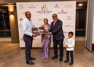 Mr. Keshra & Family (Chairman of Shreeji Group) sharing token of Appreciation to Mr. Meriton