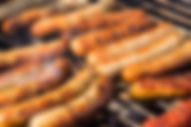 84078042-sausages-cooking-on-barbecue-gr