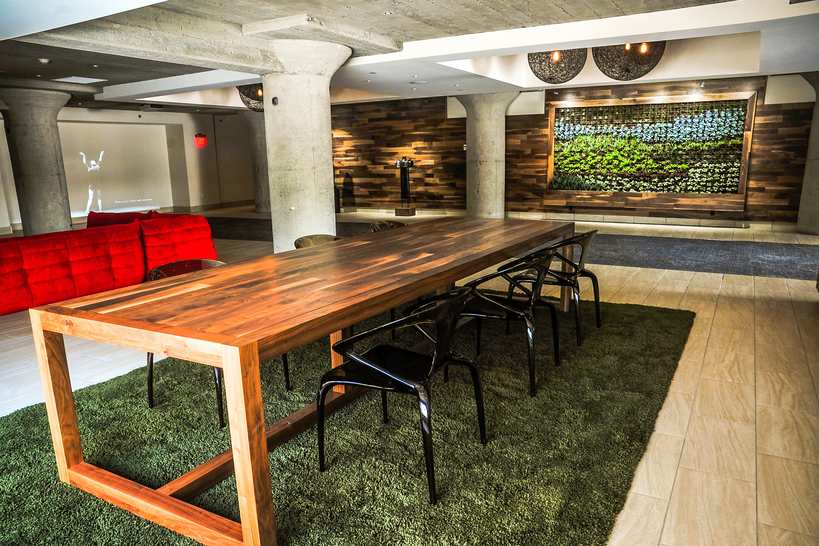 Table and living wall at Ruby Suites