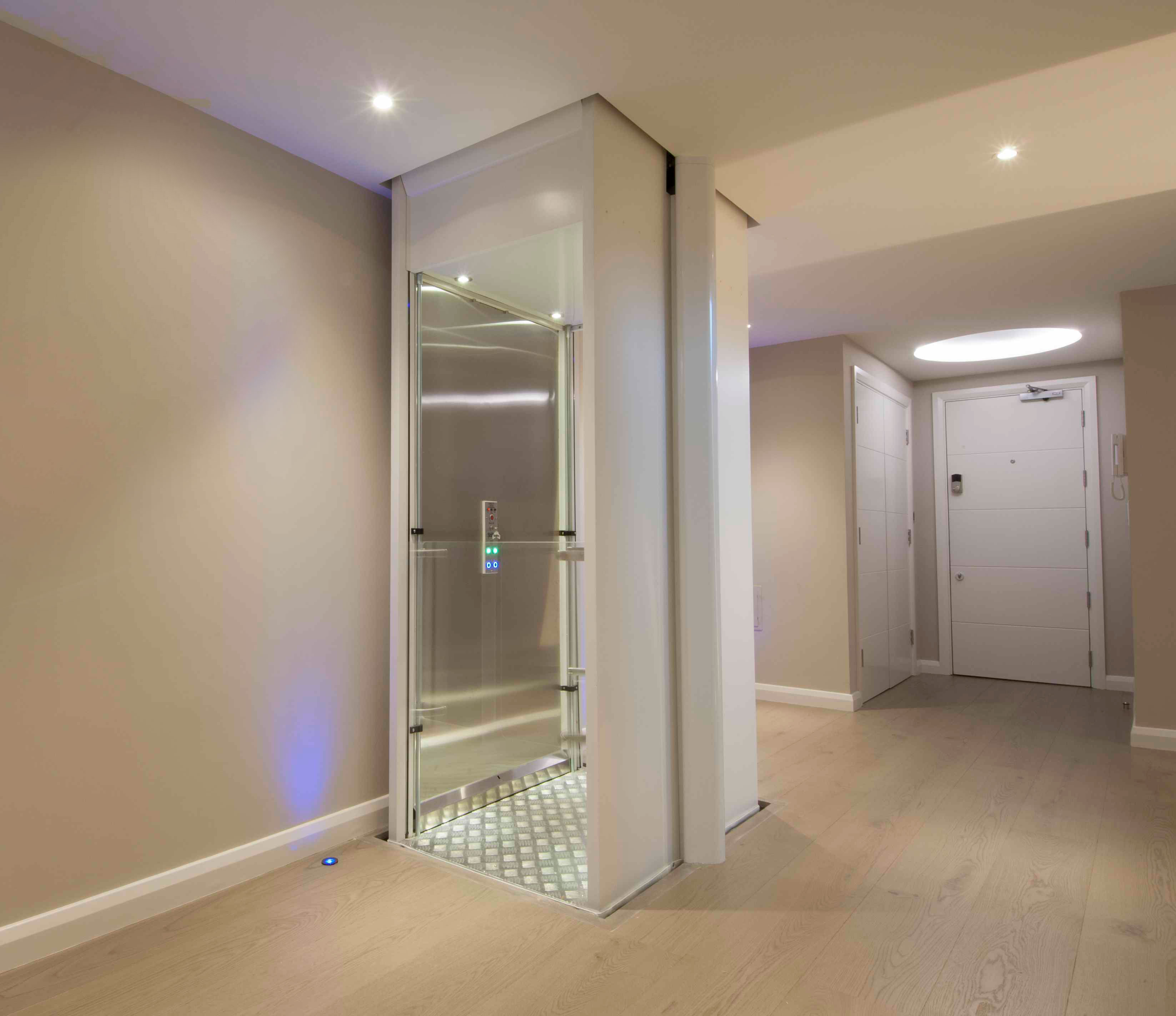 White home lift in hallway