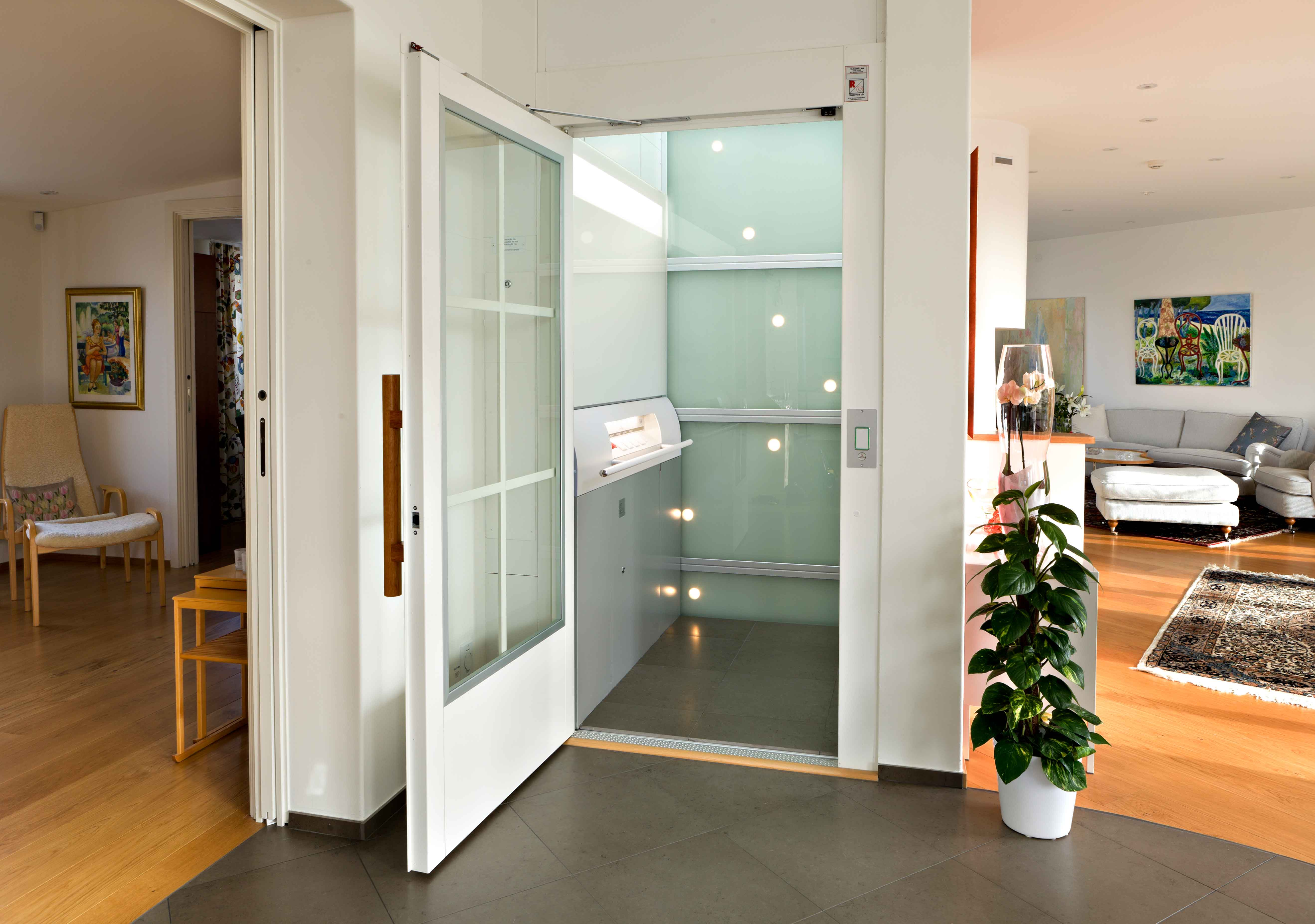Glass home lift with open door