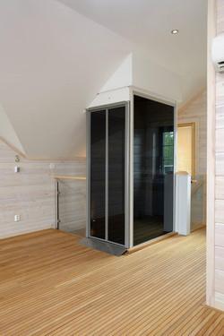 Black home lift on upstairs landing