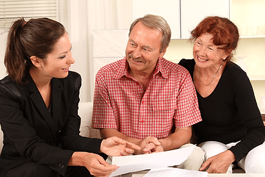 Female consultant smiling with older couple