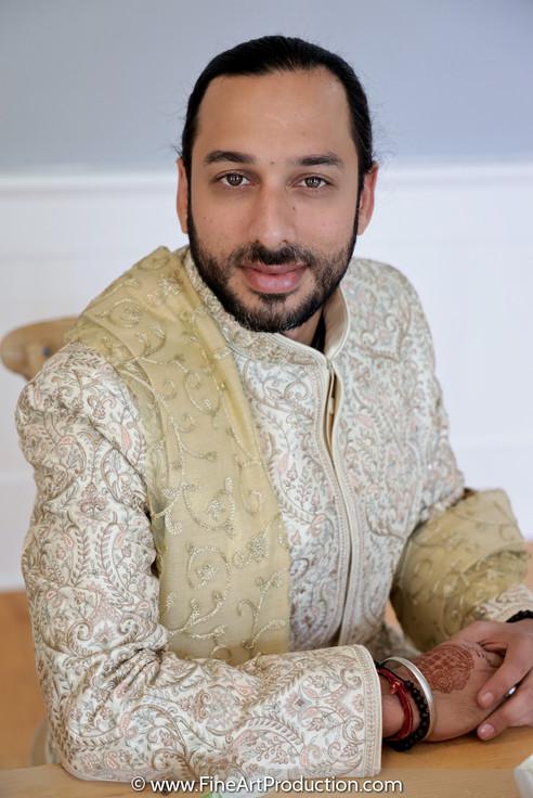 groom-posing-looking-at-camera