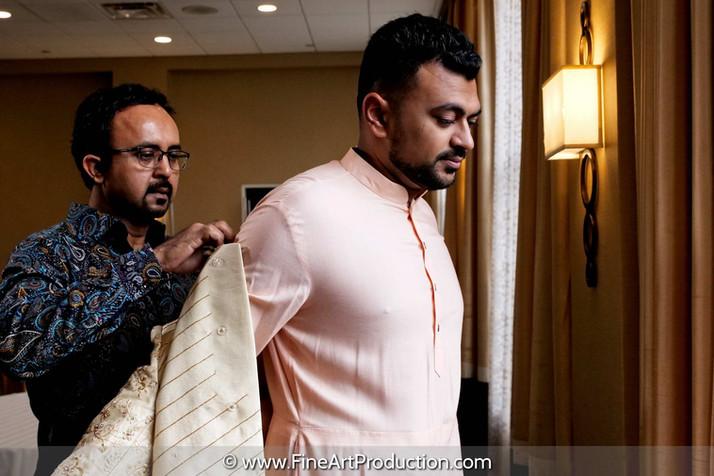 indian-groom-getting-ready-on-wedding-da
