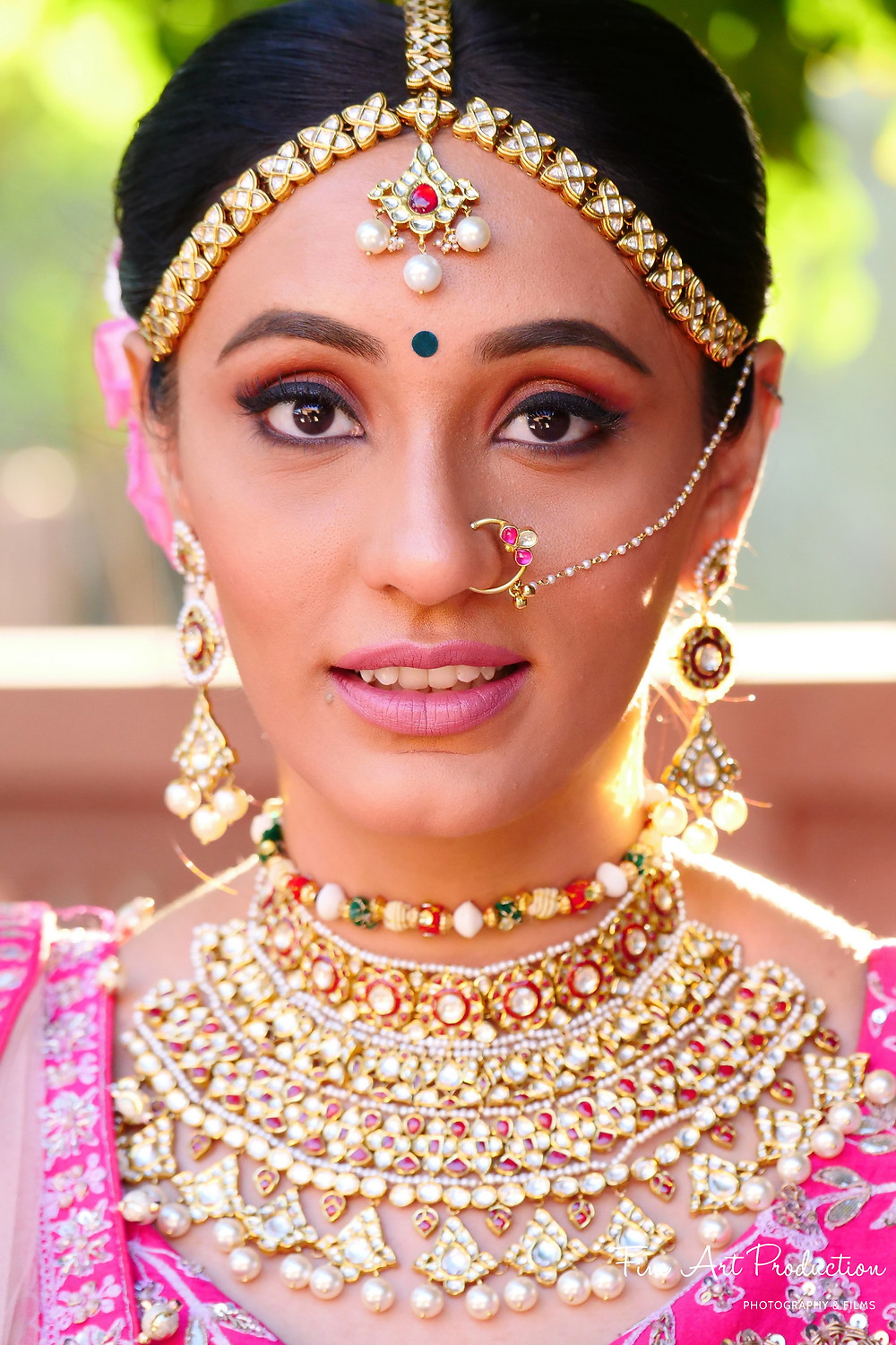 Beautiful Indian Bride on her Wedding day with her custom wedding jewelry