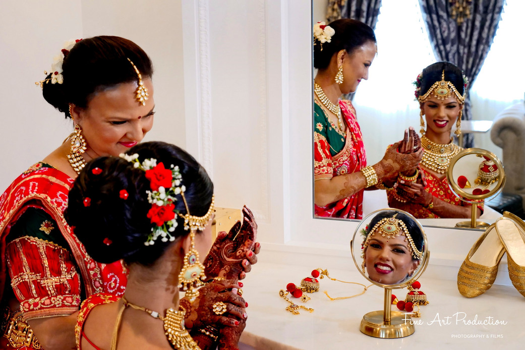 mother helping bride getting ready