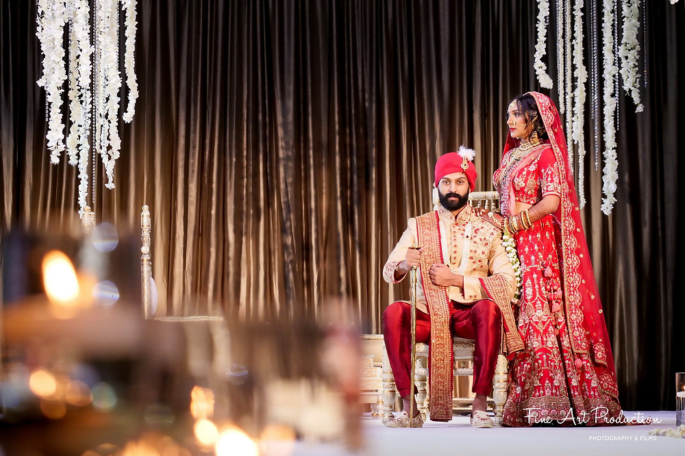 indian-wedding-couple-posing-as-king-and-queen-royal-indian-wedding-couple-hilton-orlando