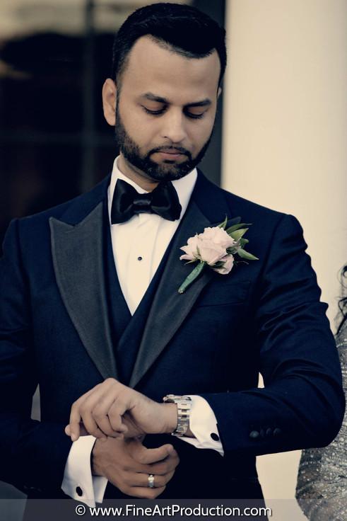 groom-looking-at-his-luxury-watch