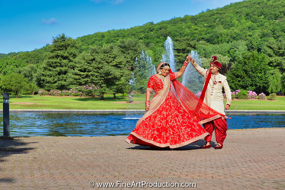 Indian Groom giving a twirl to his bride on their wedding day