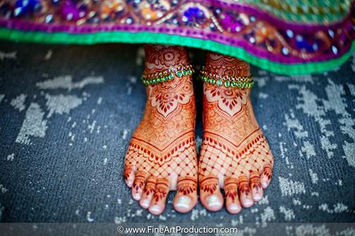Henna tattoo mehndi designs on bride's feet