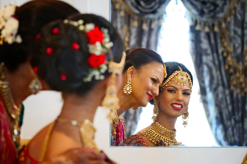 mother-helping-indian-bride-getting-read