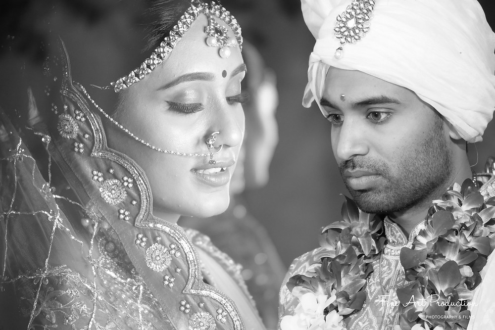 Candid moment of bride and groom during their indian wedding