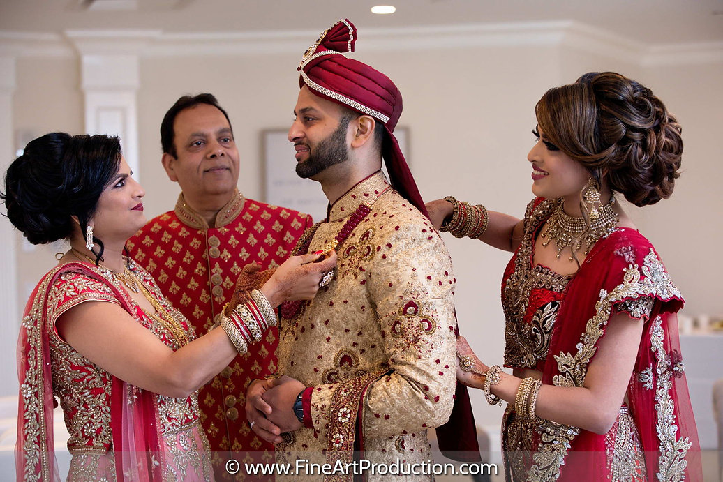 indian-groom-being-ready-by-family.jpg